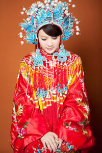 Qing dynasty styled traditional Chinese wedding dress with phoenix crown (鳳冠) headpiece still used in modern Taiwanese weddings.